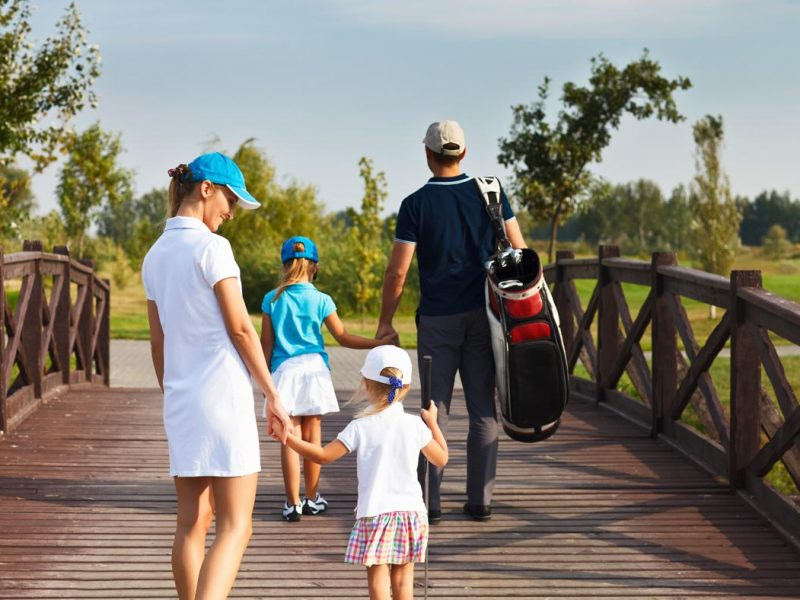 bigstock-Family-Of-Golf-Players-Walking-82259504